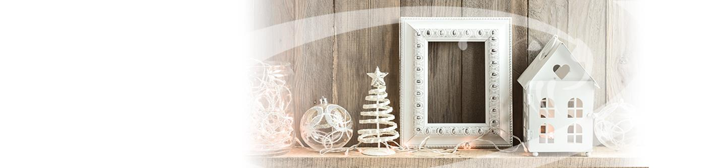 Winter image with white LED lights, small white Christmas tree, and white photo frame